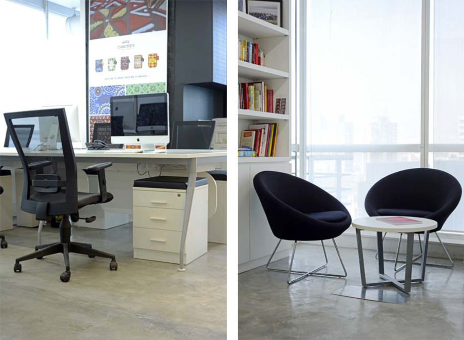 A neat and functional workstation. | Breakout area with a view of the city beyond.